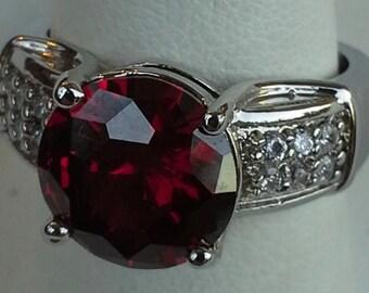 Sterling silver band ring, red garnet, white zircon