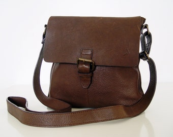Leather  Bag . Leather Boomerang.