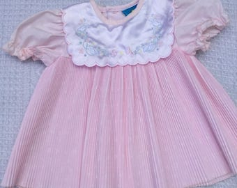 Pleated pink vintage baby dress with blue bird embroidery. Size 6 months.