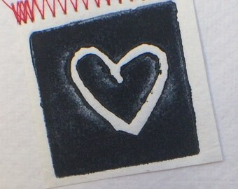 Card heart accordion has bow with envelope