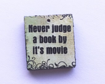 Never judge a book by its movie green wooden scrabble tile painted black handmade jewellery supplies jewelry components crafting artisan
