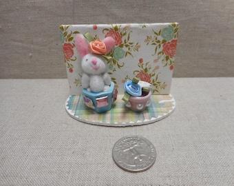 Miniature scene - bunny rabbit with rose