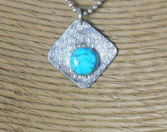 Stterling Silver Turquoise  Patterned Pendant