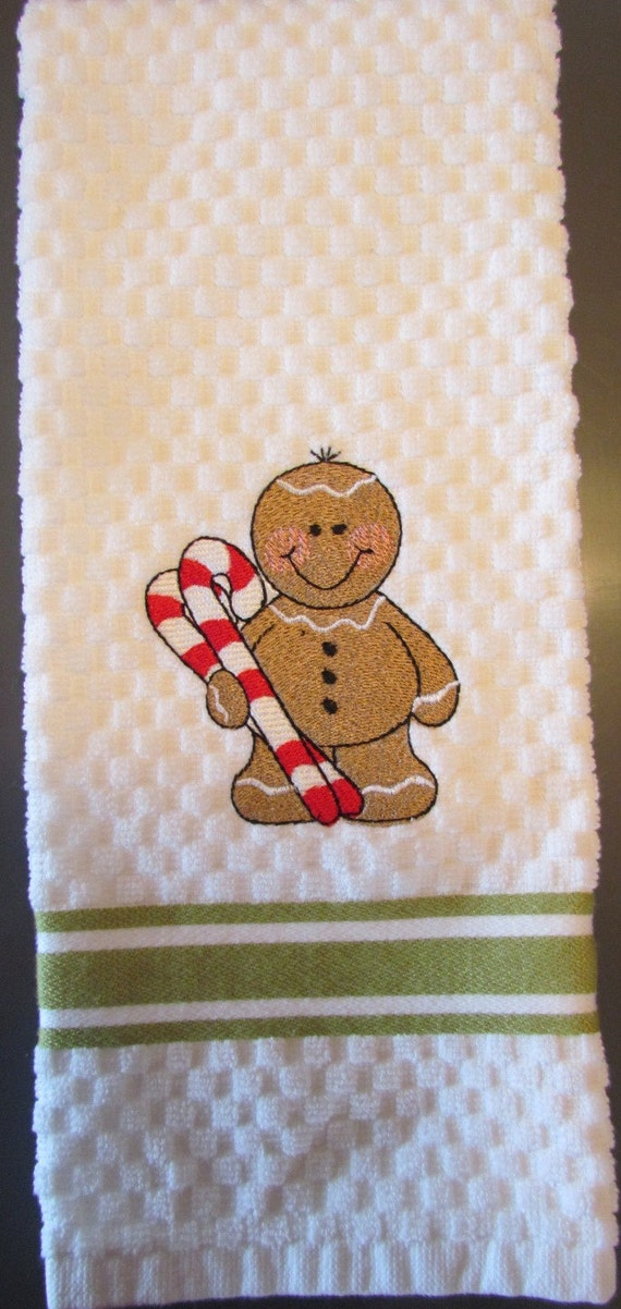 Machine embroidered kitchen towel gingerbread holding candy