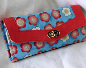 Woman's Clutch Wallet in Satsuki Blossom fabric with metallic highlights