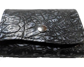 Purse from black embossed leather
