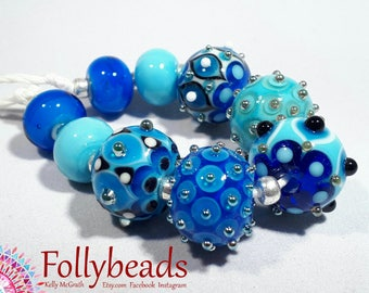 Handmade Lampwork Artisan glass bead set in white, Azure, light Blue, Black with Silver dots