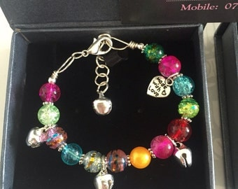 Colorful Beaded Silver bell bracelets for ages 3- 100 add a little twinkle in your life.