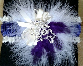 Purple, ivory and white garter with broach and feathers