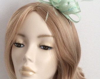 MINT GREEN FASCINATOR, Made of Sinamay, sequins, feathers,on a headband