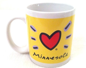 Vintage LUKE-A-TUKE Yellow MINNESOTA 10oz Coffee Mug Paul Bunyan Babe Blue Ox Heart Hearts Love Retro