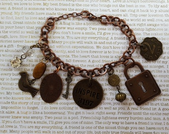 """Found Objects Mixed Metals Charm Bracelet:INSPIRE Tag, Padlock; 2 PAISE Coin; Clock; Key; Beads & Bird and Rhinestone 8"""" Chain,Lobster Clasp"""