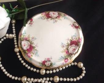 Royal Albert teapot stand/ trivet. Celebration . Bone china . First quality .
