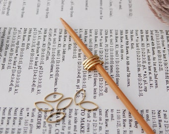 Solid stitch markers for lace knittting; pack of 10 pointed ovals with holder