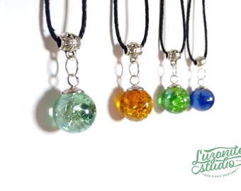 With fractures inside semitransparent glass bead pendants