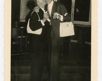 Vintage photo 'Kissing like ladies' vernacular photo snapshot - men guys duded imitating ladies, purse, kiss poking fun found photo