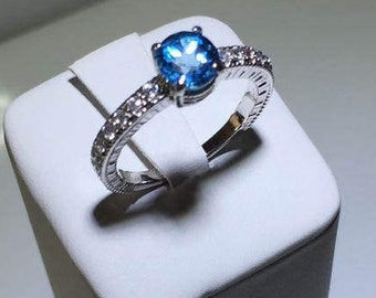 Natural Blue Topaz and Cubic Zirconia in Sterling Silver Round Engagement Ring