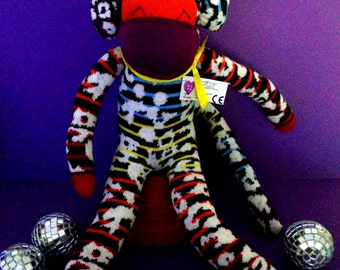 Sock monkey. rainbow gift. funky gift. colourful. Jazzy the rainbow sock monkey