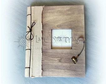 Bound in linen windowed wooden photo album
