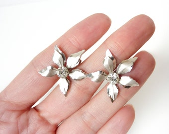 Vintage Silver Rhinestone Earrings by Bugbee & Niles in Flower Design from the 1960s