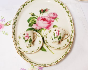 Delightful miniature part  teaset: 2 cups and saucers sit on their own tray.