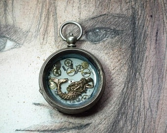 Unisex steampunk pendant   a little  self-handmade bronze eraid  swims in transparent resin  in an old pocket watchcase with gears and dial