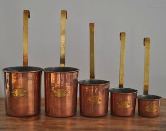 A set of 5 French vintage copper measuring cups,