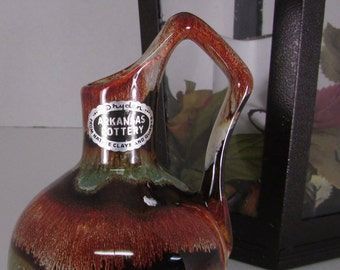 Vintage Dryden Arkansas pottery pitcher vase, sticker on spout hallmark on bottom great color glaze with rust and greens