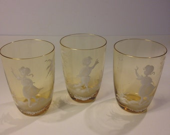Mary Gregory Style Bohemian Glass, Set of Three, Amber Color Hand Enameled Tumbler with Gold Trim