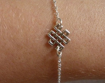Silver bracelet with the infinite Knot as an intermediate piece