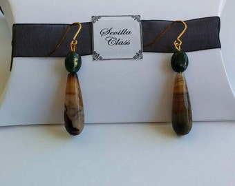 Earrings of silver with bath of gold and agates in tones Green