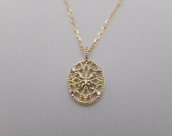 10Karat Solid Yellow Gold and Diamond Lacy Millgrain Pendant