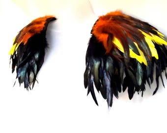 Feather epaulettes. Large black, orange and yellow feather shoulder pads. Fire Festival epaulettes. 'Sahara'