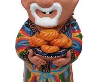 Original figurine of the ceramic Uzbek grandfather.  Ceramic figurine made of clay.