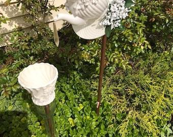 white flowers tea pot bird feeder