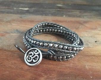 Silver Metallic OM wrap bracelet