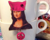 Mona Lisa wearing a Pussy Hat Brooch Fundraiser for Planned Parenthood