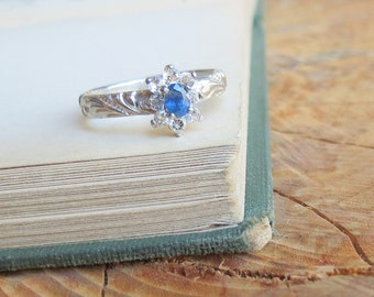 Natural Blue Oval Sapphire Engagement Ring with White topaz Gemstones in Sterling Silver