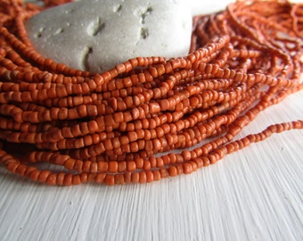 MINI orange  seed beads, orange glass bead, opaque delicate spacer  tube barre, irregular shape Indonesian - 1 to 2mm (44 inches std)6bb13-2