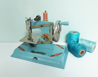 1940s KAY-an-EE Sew Master Toy Sewing Machine in Blue with Flower Decals