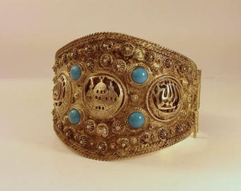 "1960's, 21/2""x21/2', hinged bracelet with temple motif"