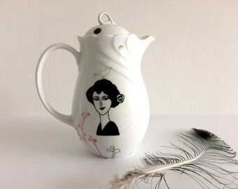 Vintage teapot with flowers and lady Emilienne