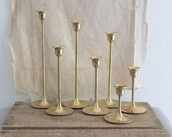 Vintage Graduated Set Of Seven Brass Candlestick Holders