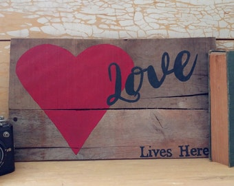 Love Lives Here Rustic Sign