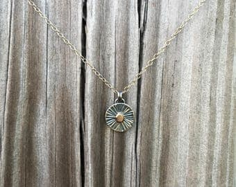 Sunburst necklace, sterling silver and gold