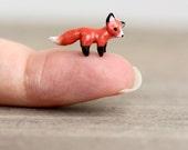 Tiny miniature clay fox