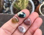 Stone Lot. 4 small ocean jasper. Four stones. Ocean Jasper. Small Trillion. Little Ovals. Sale Cabs. Triangle shaped. Pairs. Stone sets