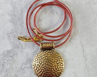 Handmade simple brick red leather necklace with a textured gold tone pendant, ready to ship, gift ready, free domestic shipping, made in MT
