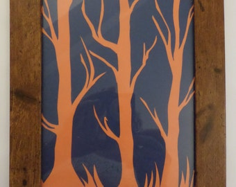 Paper cut trees, silhouette in wood effect frame.