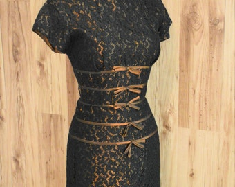 1950s Black lace overlay wiggle dress with iridescent bronze bow detail